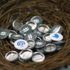 Twitter buttons in a nest.